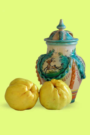 quinces: two quinces vase on green background
