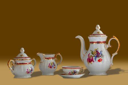sociability: Porcelain coffee set classic brown background