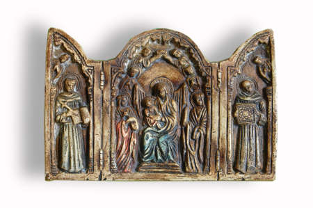 triptych: triptych of polychrome religious plaster on white background