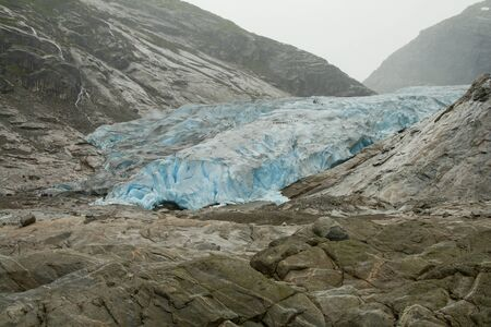 breen: Blue ice glacier front. Nigards glacier, Norway.