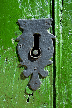 open windows: Old door lock in Castrillo de Polvazares, Spain.