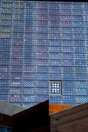 Alcobendas, Spain, june 28, 2017. Photovoltaic panels facade belong to 'Centro de Arte de Alcobendas'. Equipped with ecological installations, it generates its own energy from its windows. Banco de Imagens - 83118778