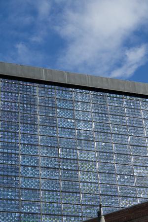 Alcobendas, Spain, june 28, 2017. Photovoltaic panels facade belong to 'Centro de Arte de Alcobendas'. Equipped with ecological installations, it generates its own energy from its windows. Banco de Imagens - 83118780