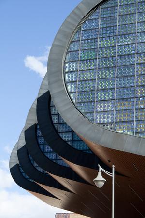 Alcobendas, Spain, june 28, 2017. Photovoltaic facade detail.Alcobendas, belong to 'Centro de Arte de Alcobendas'. Equipped with ecological installations, it generates its own energy from its windows. Banco de Imagens - 83119006