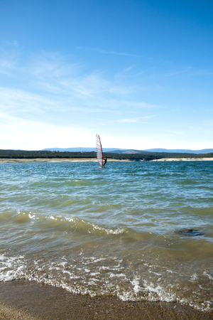 Windsurfing. Recreational water sports during summer vacation. Atazar dam, Madrid, Spain