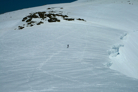 Human comparison with the human scale of snow cornices in the Sierra de Guadarrama National Park, Madrid, SpainSpectacular snow cornices between 8 and 10 thick.