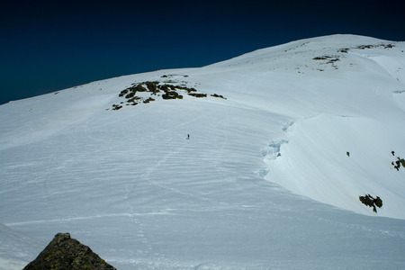 Human scale of snow cornices in the Sierra de Guadarrama National Park, Madrid, SpainSpectacular snow cornices between 8 and 10 thick.