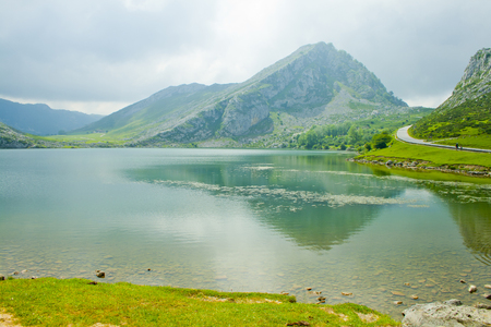 Beautiful nature of Spain: Covadonga mountain lakes in summer cloudy day. Banco de Imagens - 120659256