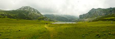 Panorama of Covadonga mountain lakes in summer cloudy day.