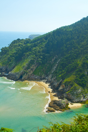 Secluded beach surrounded by amazing cliffs, Estuary of Tina Minor in Cantabria Banco de Imagens - 120659137