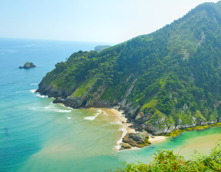 Secluded beach surrounded by amazing cliffs, Estuary of Tina Minor in Cantabria Banco de Imagens