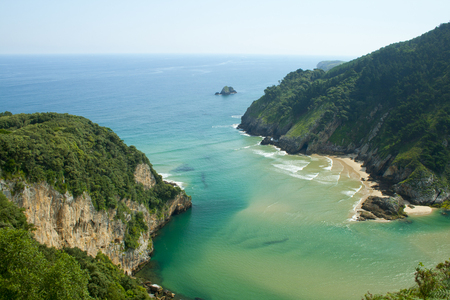 Secluded beach surrounded by amazing cliffs, Estuary of Tina Minor in Cantabria Banco de Imagens - 120659141