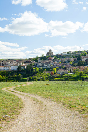 Segovia village from a nearby meadows to sunny day with some clouds