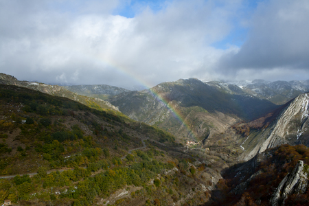 Rainbow in a mountainous landscape with beech forests. Banco de Imagens - 120659074