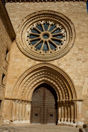 Glass and stone rosette, and door. Front view in a monsatery of Santa Mar?a de Huerta in Soria province, Spain.