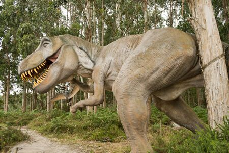 closeup and side profile view of a fierce Tyrannosaurus Rex in a forest background.