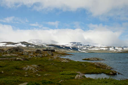 lake landscape with snowcapped mounutains in background, Finse, Norway