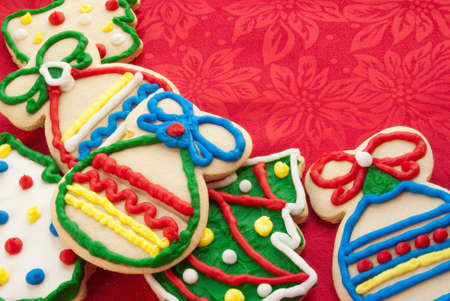 Christmas cookies in the shapes of trees and ornaments. Homemade. Red cloth copy space. Shot in natural light. Stock Photo - 17700868