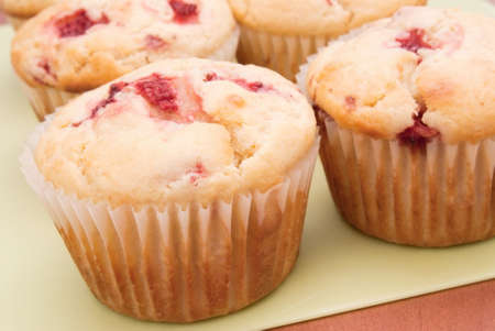 Homemade strawberry muffins. Made with buttermilk and frozen berries. shallow DOF. Shot in natural day light.  Stock Photo - 17700830