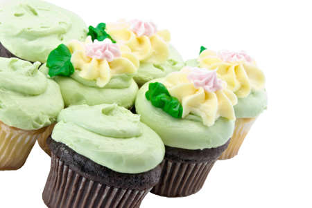 chocolate and yellow cupcakes decorated with pastel colored icing.