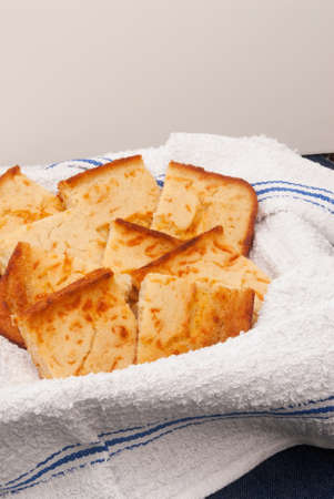 homemade corn bread served on a white dish towel. Neutral background for your own copy or replace.