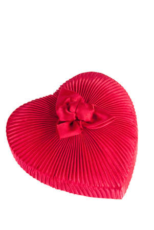 Heart shaped gift box covered in fabric isolated on white background.