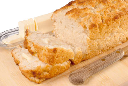 beer bread served with butter on a cutting board. An old knife was used for the cutting. Stock Photo - 17700887