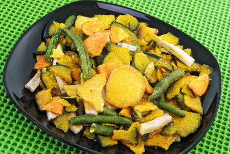 baked vegetable chips. Sweet potatoes, green beans, taro, squash.  Stock Photo