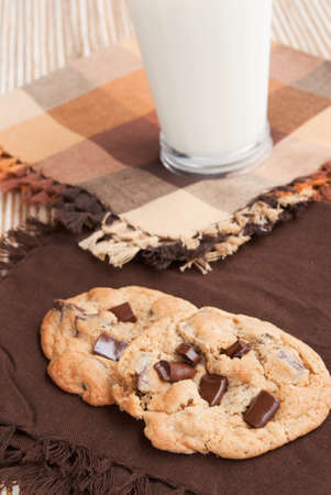chocolate chip cookies served with a glass of milk. Shallow DOF and focus is on the cookies. Stock Photo - 17700886