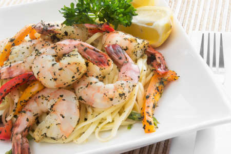 shrimp and linguini made with basil, asparagus and bell peppers.  photo