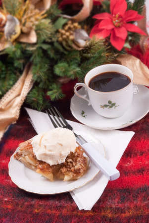 Apple pie a la mode served on antique china. Christmas theme. Selective focus.  Stock Photo - 17805382
