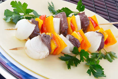 grilled shish kebab made of sirloin steak, bell peppers, sweet vidalia onions and garnished with Italian parsley.