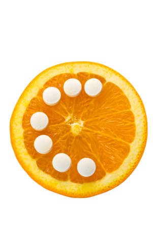 orange half with vitamin c tablets spelling the letter c on an isolated background including a clipping path photo