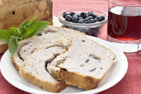 blueberry cobbler bread served with blueberries, grape juice and garnished with mint.