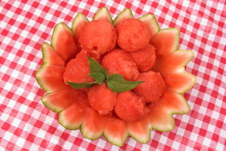 Watermelon balls in a decorative rind. Garnished with Stevia.