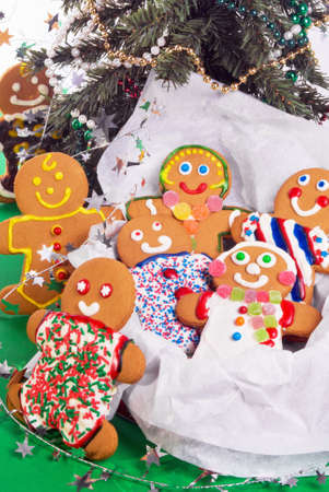 gingerbread man woman children under a Christmas tree. photo