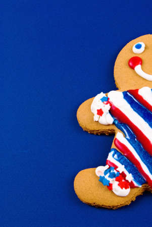 gingerbread man is showing leaving plenty of copy space on this blue card stock background. Stock Photo - 18503140