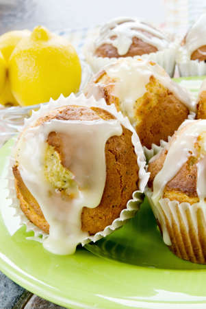 Muffins made with lemons and poppy seeds. Glazed icing on top.