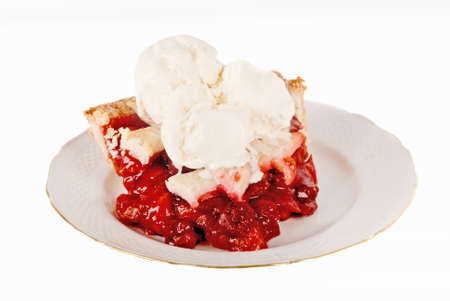 cherry pie a la mode with vanilla bean ice cream served on an antique plate.  photo