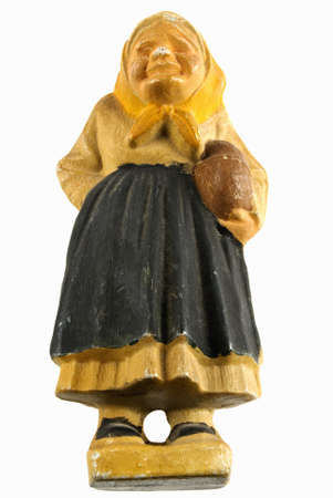 grungy antique wood carved figurine of a peasant woman. photo