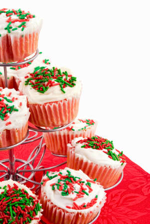 christmas cake: christmas cupcakes in a holder on a white background.