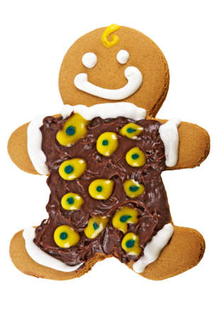 gingerbread man dressed in a dark chocolate outfit that has lots of yellow polka dots and bright white trim.