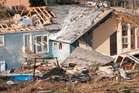 damaged houses: Tornado damaged house  Could be the result of any natural disaster