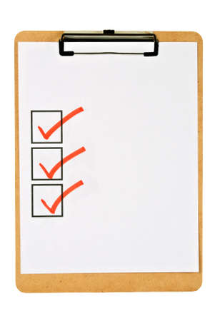 cork clipboard holding blank paper that has three square boxes checked off with a red marker. Isolated on white.