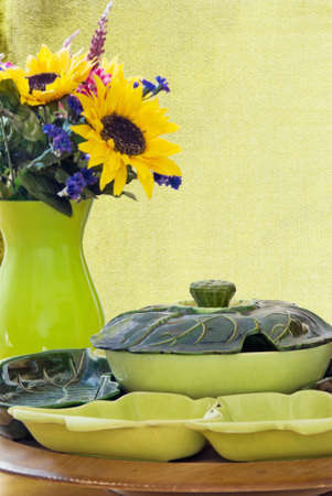 1950s antique lazy susan with flower arrangement in background. Shallow definition of field.  photo