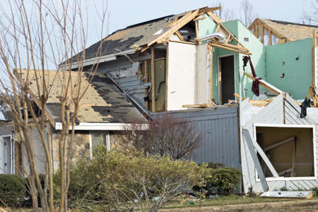 natural disaster: wood framed house destroyed by an EF2 natural disaster tornado during the month of March.