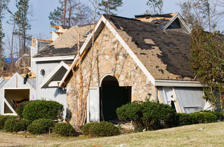This wood frame and stone house was totally destroyed by this natural disaster. An EF2 tornado touched down in this residential neighborhood in the early spring. The house had to be leveled and a new home was built in its place. Stock Photo