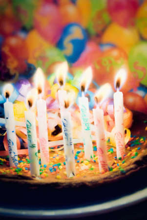 dark chocolate: Dark chocolate brownie birthday cake with eight happy birthday burning candles. the cake is covered with sprinkles and chocolate icing. This is computer generated art from a photograph.