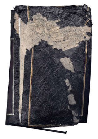 very grungy old black hardcover book that is isolated on a white background. This book has been run over with a vehicle and ground small rocks are embedded in the material. It is torn, ripped, stained, smudged, and extremely dirty. Stock Photo