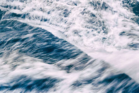 of movement: A close-up view from the top of a waterfall as the water flows downward creates an abstract of movement. A slow shutter speed and long exposure creates the beauty of movement. Stock Photo